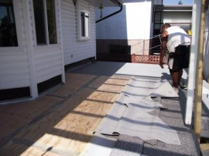 "Glueing down ""vinyl deck covering"""