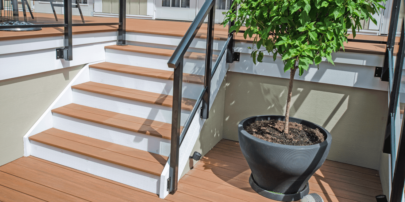 Azek deck and stairs with aluminum glass railings