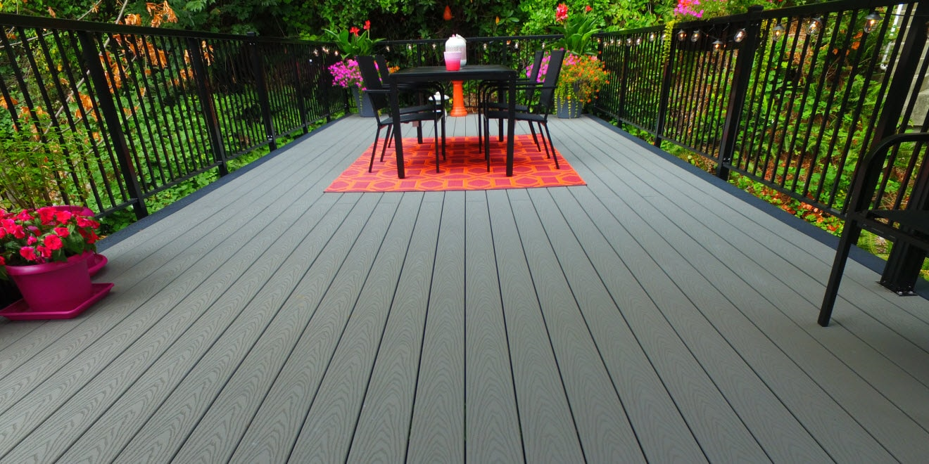 Composite deck with aluminum picket railing