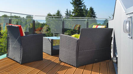 Outdoor furniture on hardwood deck