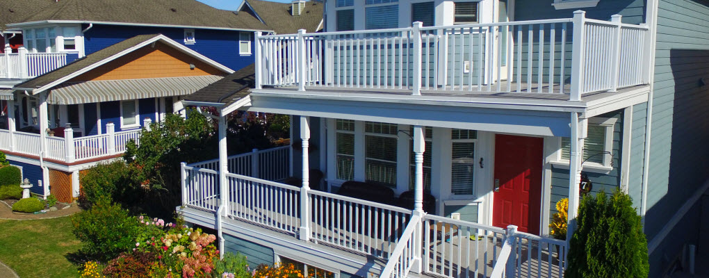 high end deck railings on outside of nice house