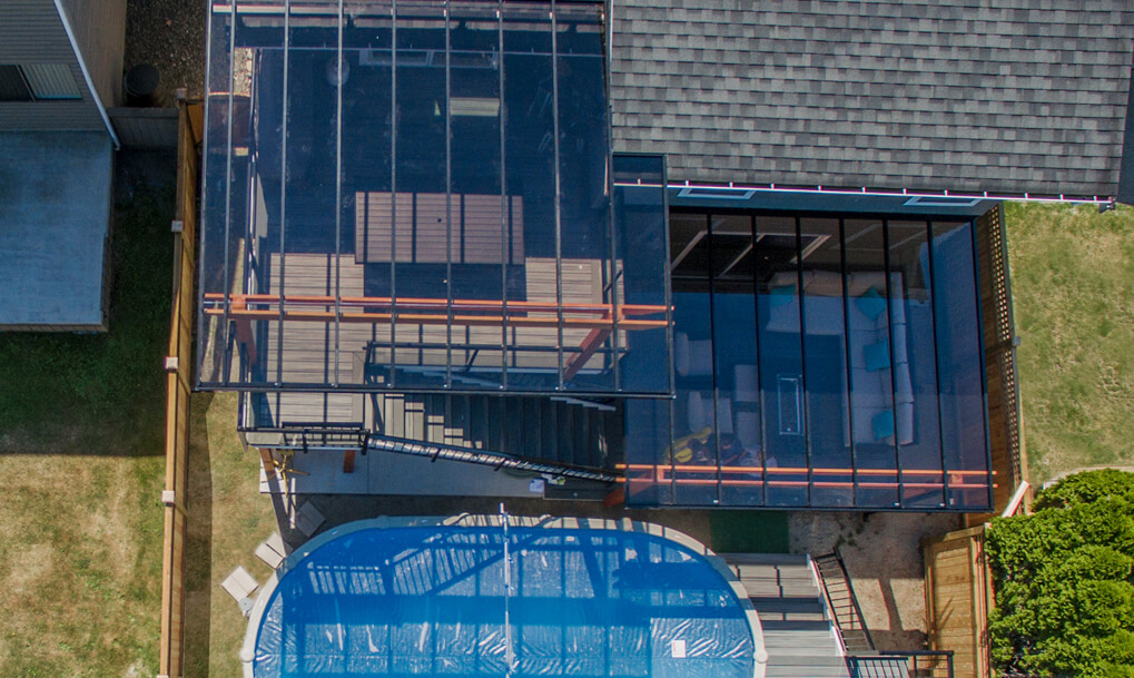 Overhead view of glass canopy and composite deck